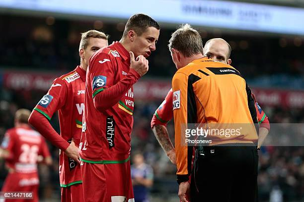 Adam Marusic midfielder of KV Oostende in discussion with referee Serge Gumienny pictured during the Jupiler Pro League match between RSC Anderlecht...