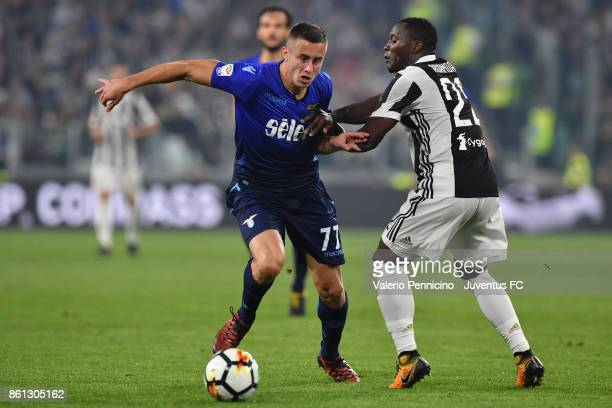 Adam Marusic of Lazio and Kwadwo Asamoah of Juventus compete for the ball during the Serie A match between Juventus and SS Lazio on October 14 2017...