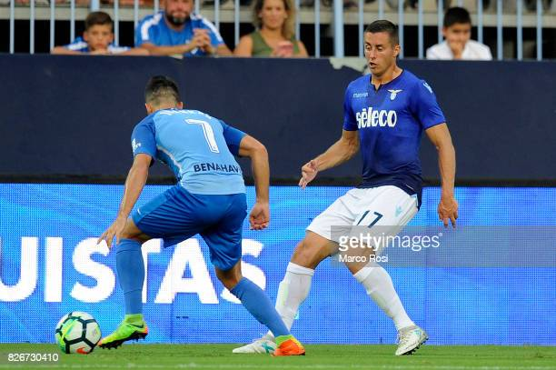 Adam Marusic of SS Lazio compete for the ball with Jaunkar of Malaga CF during the PreSeason Friendly match between Malaga CF and SS Lazio at Estadio...