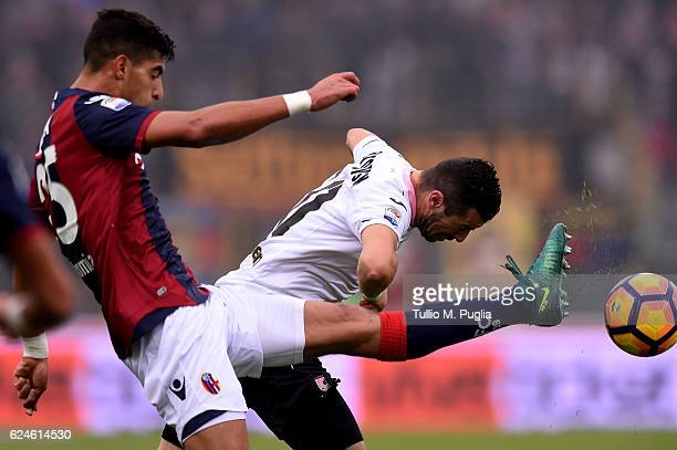 Adam Masina of Bologna and Ilija Nestorovski of Palermo compete for the ball during the Serie A match between Bologna FC and US Citta di Palermo at...