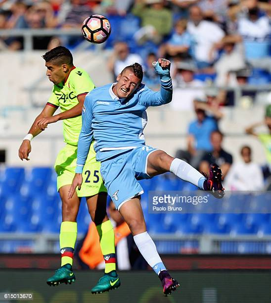 Adam Masina of Bologna FC competes for the ball with Sergej Milinkovic of SS Lazio during the Serie A match between SS Lazio and Bologna FC at Stadio...