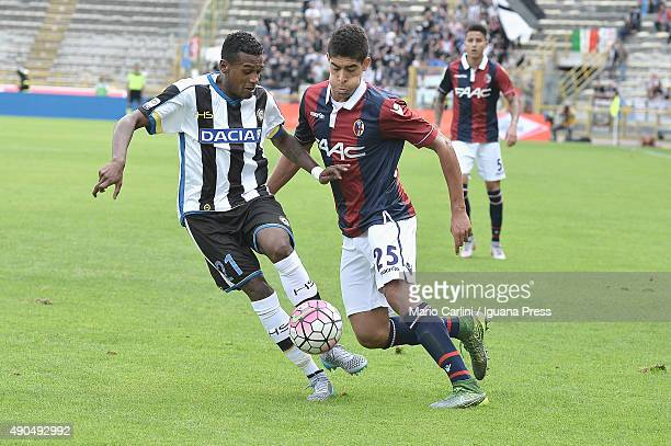Adam Masina of Bologna FC competes the ball with Andrare Edenilson of Udinese Calcio during the Serie A match between Bologna FC and Udinese Calcio...