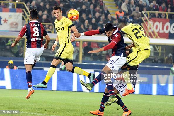 Adam Masina of Bologna FC competes the ball with Joao Miranda of Internazionale Milano during the Serie A match between Bologna FC and FC...