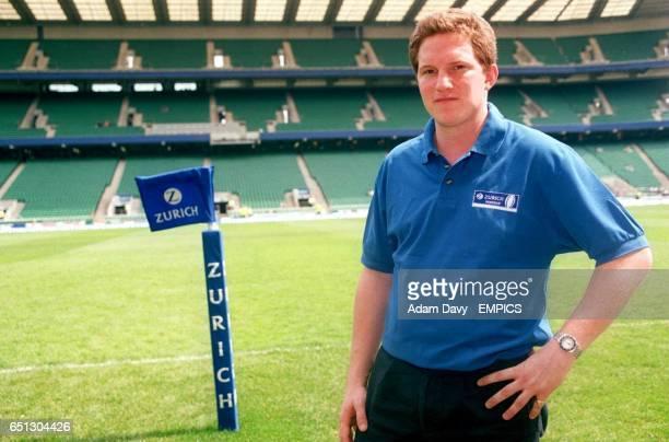 Adam Mason wearing a Zurich polo shirt at Twickenham