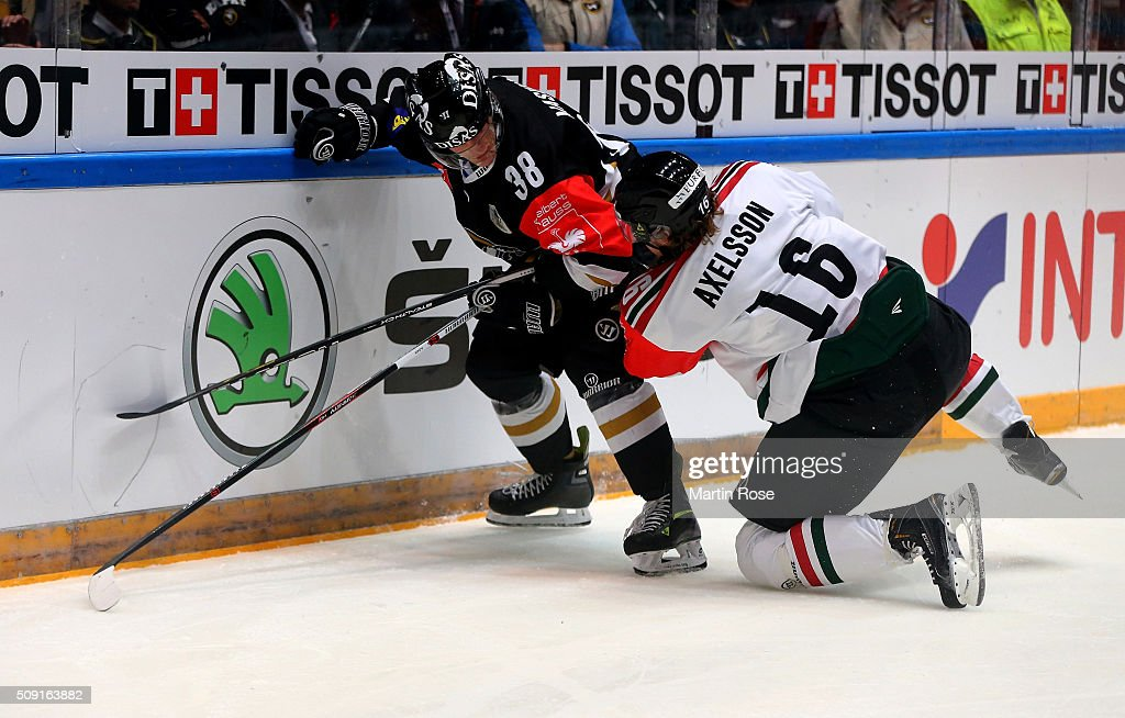 Adam Masuhr #38 of Oulu and Anton Axelsson of Gothenburg battle for the puck during the Champions Hockey League final game between Karpat Oulu and Frolunda Gothenburg at Oulun Energia-Areena on February 9, 2016 in Oulu, Finland.