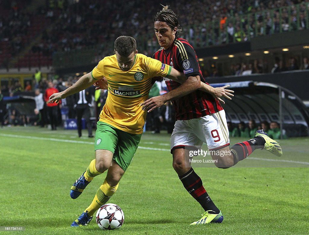 Adam Matthews of Celtic competes for the ball with <a gi-track='captionPersonalityLinkClicked' href=/galleries/search?phrase=Alessandro+Matri&family=editorial&specificpeople=4501520 ng-click='$event.stopPropagation()'>Alessandro Matri</a> of AC Milan during the UEFA Champions League group H match between AC Milan and Celtic at Stadio Giuseppe Meazza on September 18, 2013 in Milan, Italy.