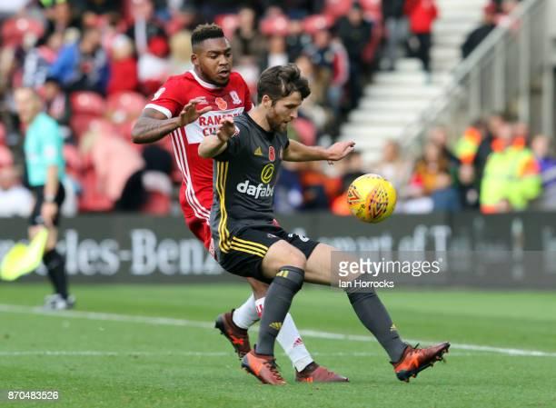 Adam Matthews of Sunderland holds off the challenge of Britt Assombalonga of Middlesbrough during the Sky Bet Championship match between...