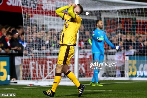 Adam May of Sutton United reacts after missing an opportunity as David Ospina of Arsenal reacts during the Emirates FA Cup fifth round match between...