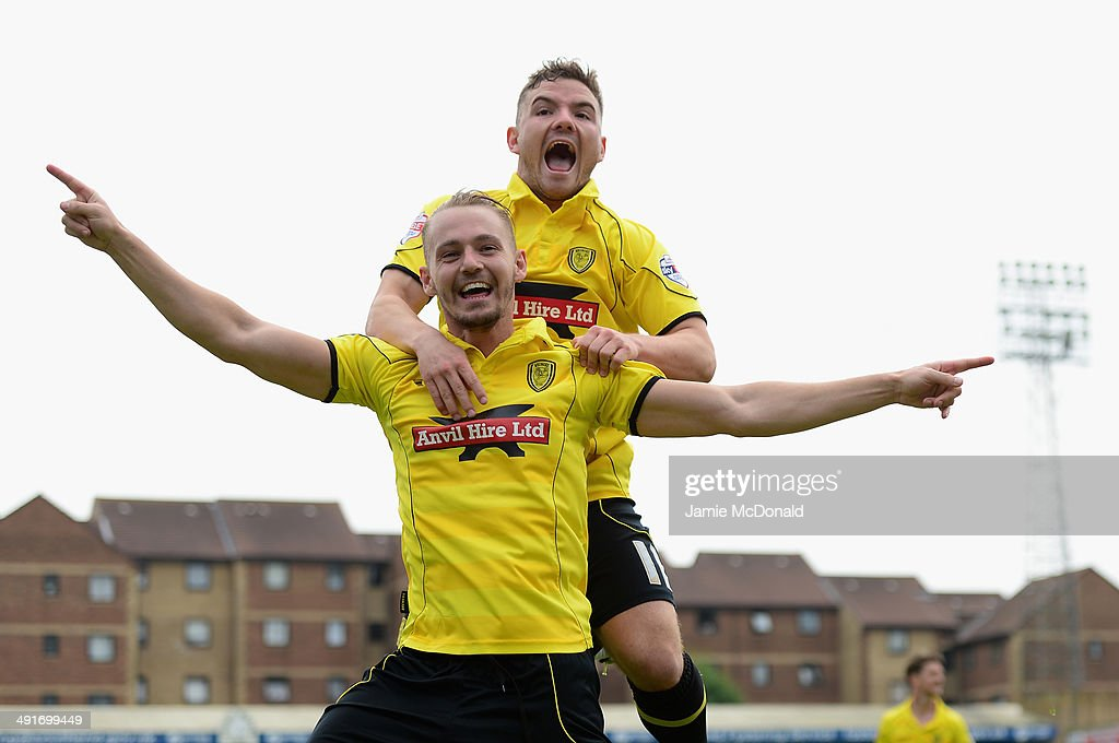Adam McGurk of Burton Albion celebrates his goal with Alex McDonald during the Sky Bet League Two semi-final, second leg match between Southend United and Burton Albion at Roots Hall on May 17, 2014 in Southend, England.