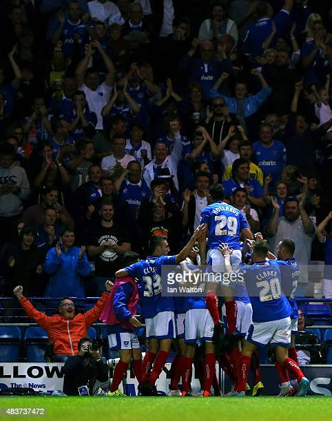 Adam McGurk of Portsmouth celebrates scoring a goal during the Capital One Cup First Round match between Portsmouth v Derby County at Fratton Park on...