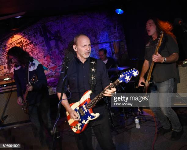 Adam McIntyre Wayne Kramer Adam Renshaw and Shannon Mulvaney perform during the Artist2Artist Benefit For Homeless Veterans at The Office on August 5...