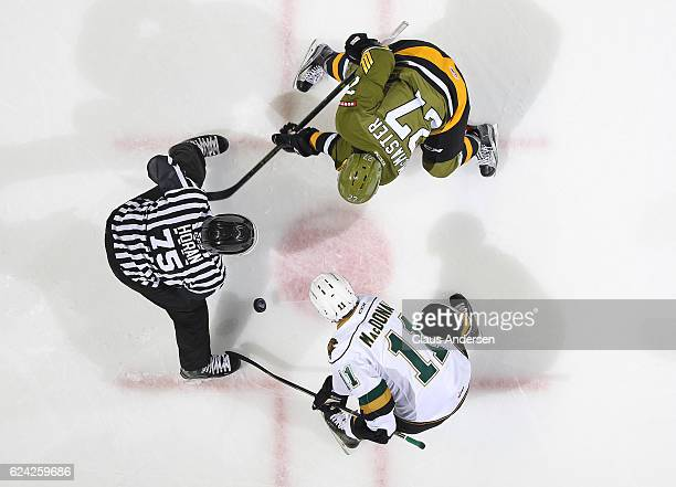 Adam McMaster of the North Bay Battalion takes a faceoff against Owen MacDonald of the London Knights during an OHL game at the Budweiser Gardens on...