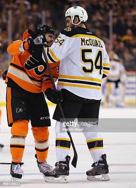 Adam McQuaid of the Boston Bruins and Zac Rinaldo of the Philadelphia Flyers fight in the first period at TD Garden on March 7 2015 in Boston...
