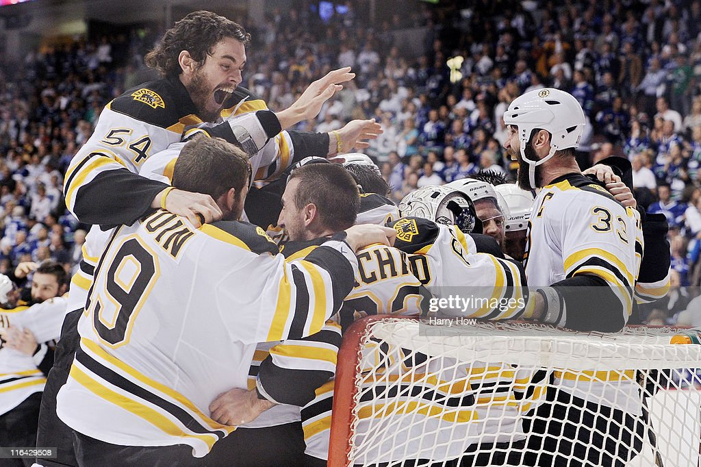 <a gi-track='captionPersonalityLinkClicked' href=/galleries/search?phrase=Adam+McQuaid&family=editorial&specificpeople=2238883 ng-click='$event.stopPropagation()'>Adam McQuaid</a> #54 of the Boston Bruins celebrates with his teammates <a gi-track='captionPersonalityLinkClicked' href=/galleries/search?phrase=Brad+Marchand&family=editorial&specificpeople=2282544 ng-click='$event.stopPropagation()'>Brad Marchand</a> #63, <a gi-track='captionPersonalityLinkClicked' href=/galleries/search?phrase=Tyler+Seguin&family=editorial&specificpeople=6698848 ng-click='$event.stopPropagation()'>Tyler Seguin</a> #19, Tim Thomas #30 and <a gi-track='captionPersonalityLinkClicked' href=/galleries/search?phrase=Zdeno+Chara&family=editorial&specificpeople=203177 ng-click='$event.stopPropagation()'>Zdeno Chara</a> #33 after defeating the Vancouver Canucks in Game Seven of the 2011 NHL Stanley Cup Final at Rogers Arena on June 15, 2011 in Vancouver, British Columbia, Canada. The Boston Bruins defeated the Vancouver Canucks 4 to 0.