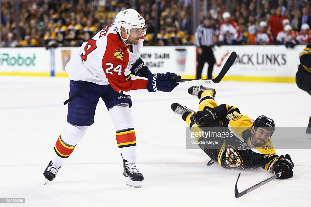 <a gi-track='captionPersonalityLinkClicked' href=/galleries/search?phrase=Adam+McQuaid&family=editorial&specificpeople=2238883 ng-click='$event.stopPropagation()'>Adam McQuaid</a> #54 of the Boston Bruins dives after a shot by <a gi-track='captionPersonalityLinkClicked' href=/galleries/search?phrase=Brad+Boyes&family=editorial&specificpeople=275014 ng-click='$event.stopPropagation()'>Brad Boyes</a> #24 of the Florida Panthers during the second period at TD Garden on March 31, 2015 in Boston, Massachusetts.
