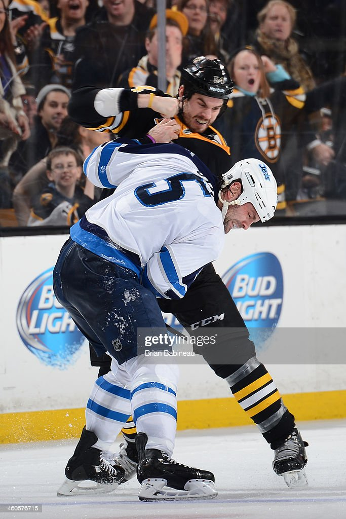 <a gi-track='captionPersonalityLinkClicked' href=/galleries/search?phrase=Adam+McQuaid&family=editorial&specificpeople=2238883 ng-click='$event.stopPropagation()'>Adam McQuaid</a> #54 of the Boston Bruins fights against Mark Stuart #5 of the Winnipeg Jets at the TD Garden on January 4, 2014 in Boston, Massachusetts.