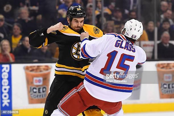 Adam McQuaid of the Boston Bruins fights against Tanner Glass of the New York Rangers at the TD Garden on January 15 2015 in Boston Massachusetts