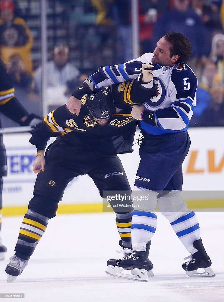 <a gi-track='captionPersonalityLinkClicked' href=/galleries/search?phrase=Adam+McQuaid&family=editorial&specificpeople=2238883 ng-click='$event.stopPropagation()'>Adam McQuaid</a> #54 of the Boston Bruins fights Mark Stuart #5 of the Winnipeg Jets in the third period during the game at TD Garden on January 4, 2014 in Boston, Massachusetts.