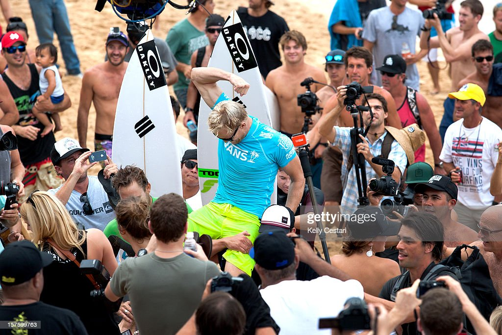 Adam Melling of Australia is carried up the beach after winning the final of the Vans World Cup of Surfing at Sunset Beach and requalifying for the ASP World Tour on December 4, 2012 in North Shore, Hawaii.