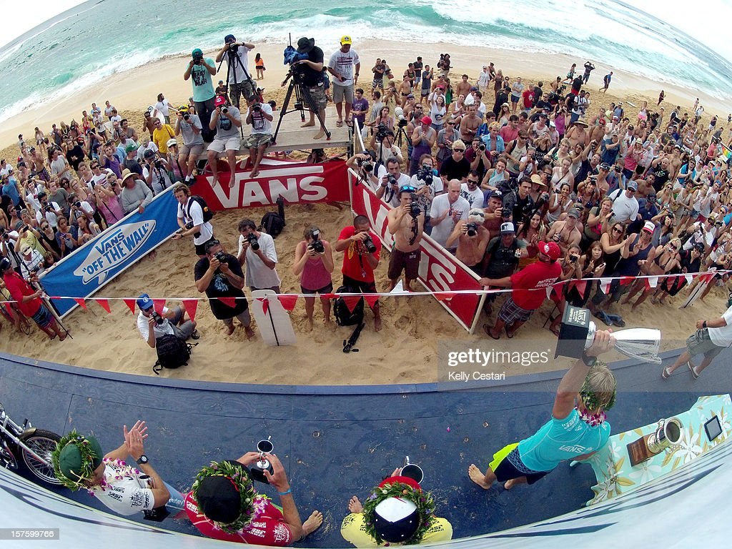 Adam Melling of Australia raises his trophy on stage after winning the final of the Vans World Cup of Surfing at Sunset Beach and requalifying for the ASP World Tour on December 4, 2012 in North Shore, Hawaii.