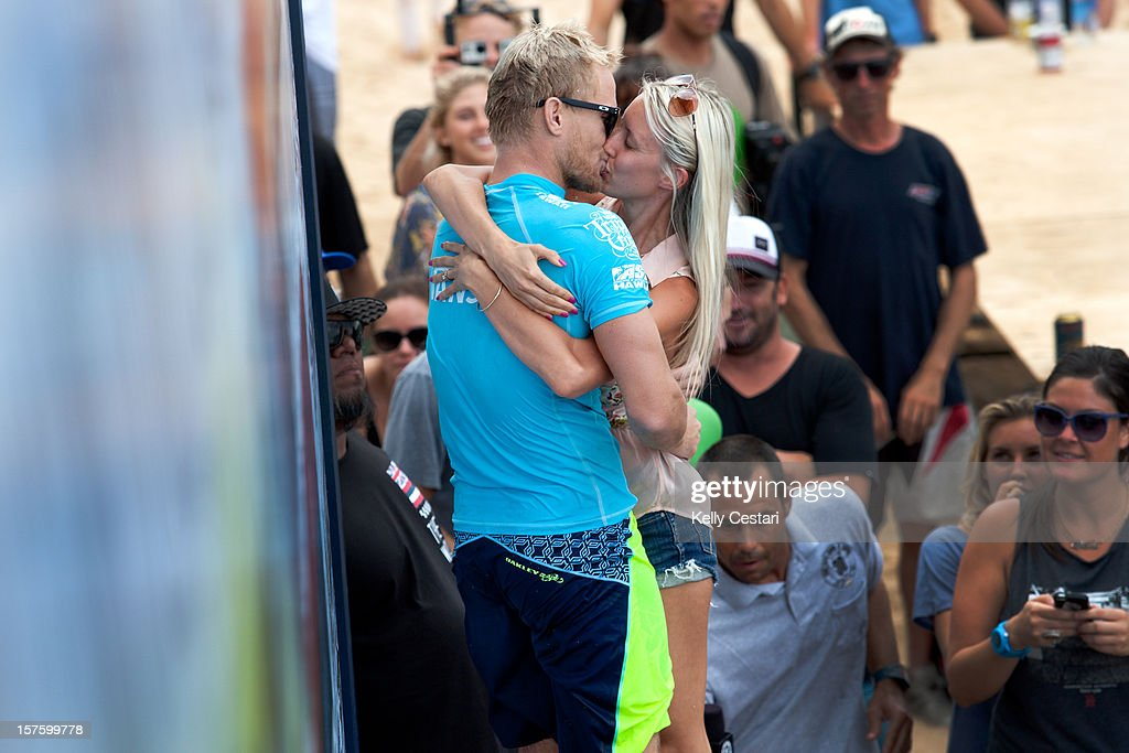 Adam Melling of Australia receives a kiss from his partner after winning the final of the Vans World Cup of Surfing at Sunset Beach and requalifying for the ASP World Tour on December 4, 2012 in North Shore, Hawaii.