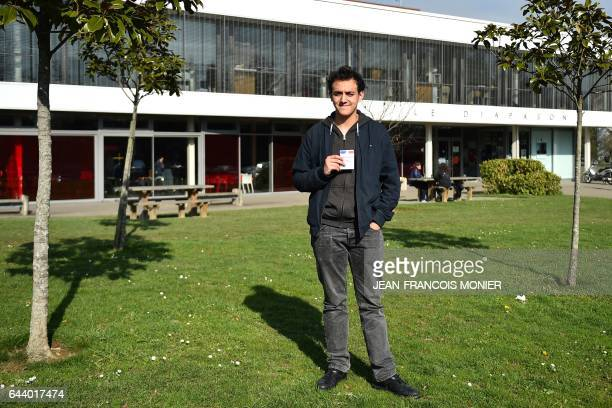 Adam Mersit studying for a physics and chemistry degree poses with his voting card on February 17 2017 at Rennes 1 university in western France What...