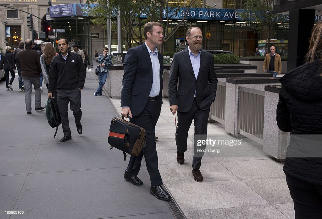 Adam Messinger, chief technology officer of Twitter Inc., right, arrives at JPMorgan Chase & Co. headquarters in New York, U.S., on Friday, Oct. 25, 2013. Twitter Inc. will make the case to potential investors in its initial public offering that it needs to keep spending to grow, and profit will come once it can reap the benefits of those investments. Photographer: Scott Eells/Bloomberg via Getty Images