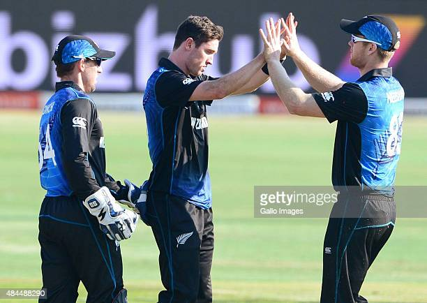 Adam Milne and James Neesham of New Zealand celebrate the wicket of Hashim Amla of the Proteas during the 1st ODI match between South Africa and New...