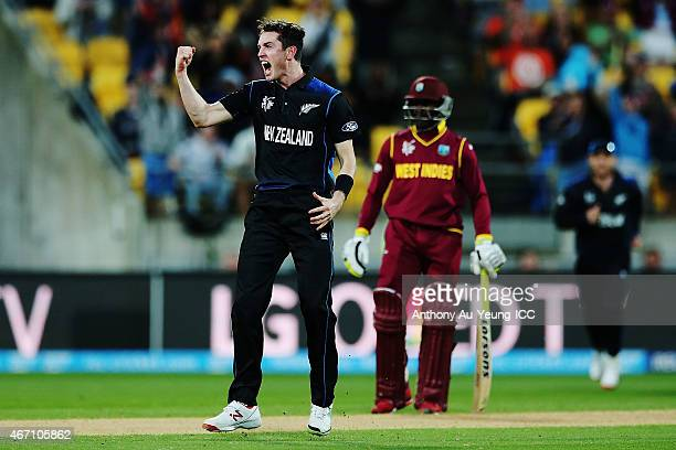 Adam Milne of New Zealand celebrates getting the wicket of Chris Gayle of West Indies during the 2015 ICC Cricket World Cup match between New Zealand...