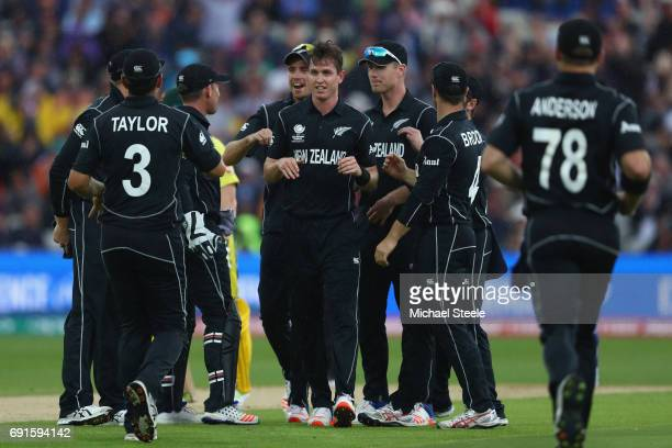 Adam Milne of New Zealand celebrates taking the caught and bowled wicket of Moises Henriques of Australia during the ICC Champions Trophy match...