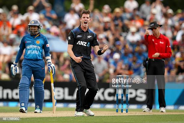 Adam Milne of New Zealand celebrates the wicket of Dimuth Karunaratne of Sri Lanka during the One Day International match between New Zealand and Sri...
