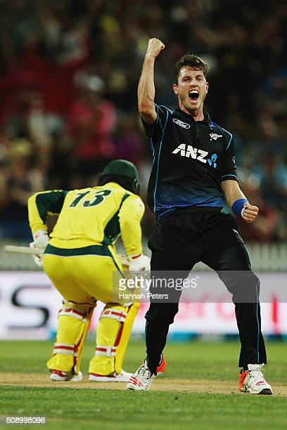 Adam Milne of the Black Caps celebrates the wicket of Matthew Wade of Australia during the 3rd One Day International cricket match between the New...