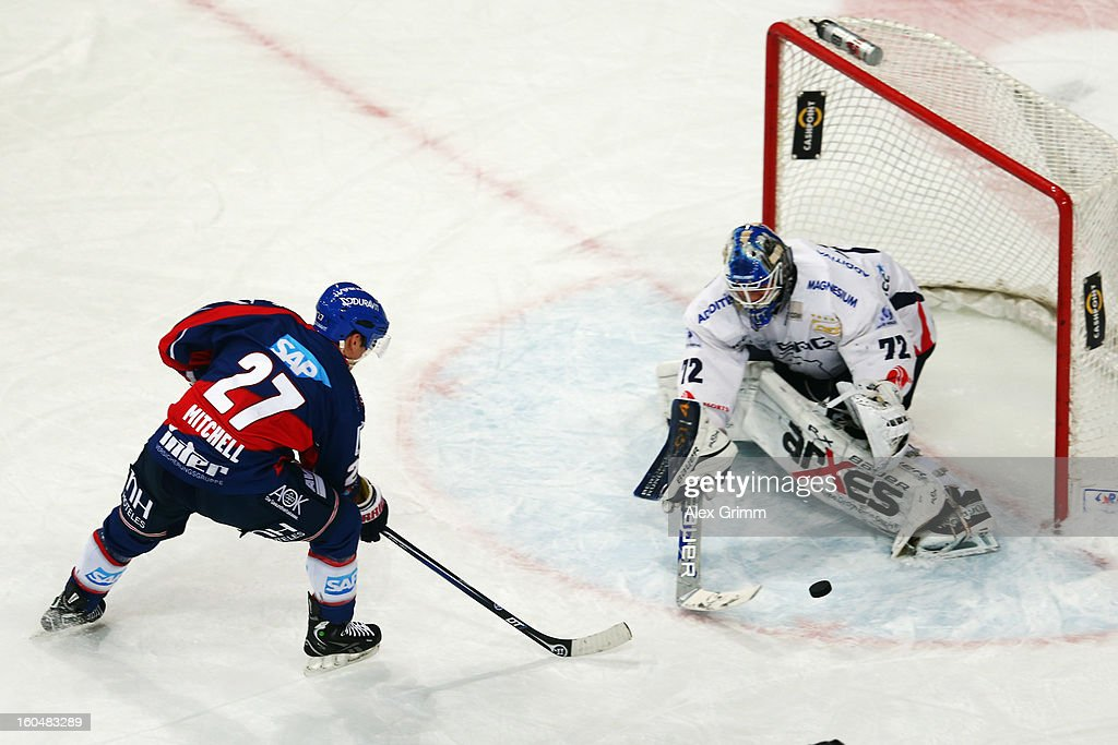 Adam Mitchell of Mannheim tries to score against goalkeeper <a gi-track='captionPersonalityLinkClicked' href=/galleries/search?phrase=Rob+Zepp&family=editorial&specificpeople=3121630 ng-click='$event.stopPropagation()'>Rob Zepp</a> of Berlin during the DEL match between Adler Mannheim and Eisbaeren Berlin at SAP Arena on February 1, 2013 in Mannheim, Germany.