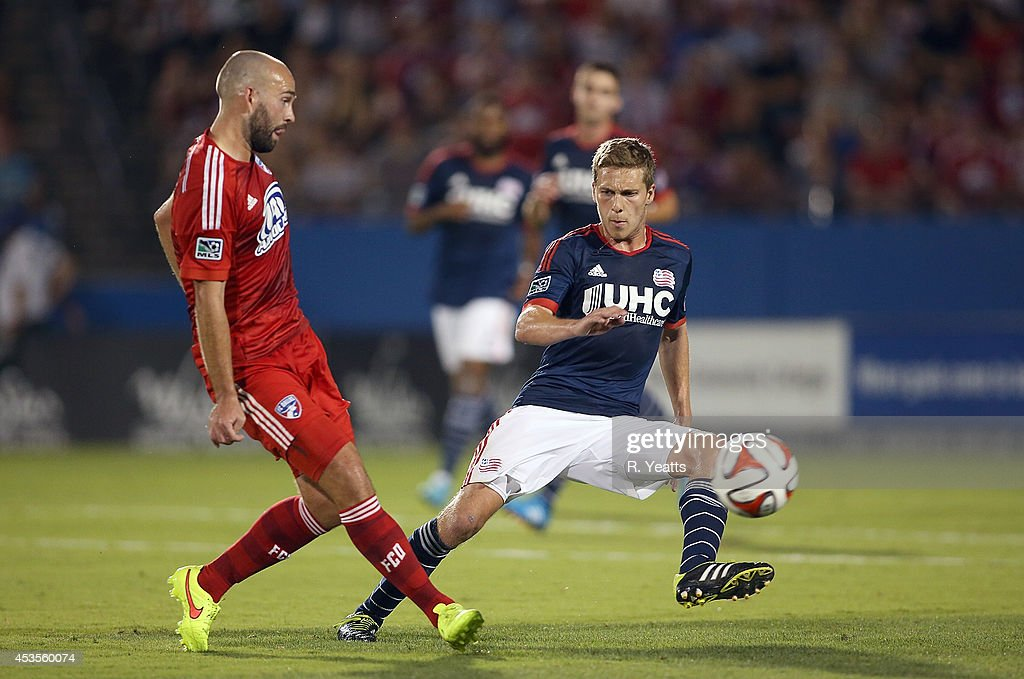 Adam Moffat #6 of FC Dallas kicks the ball past Scott Caldwell #6 of New England Revolution at Toyota Stadium on July 19, 2014 in Frisco, Texas.