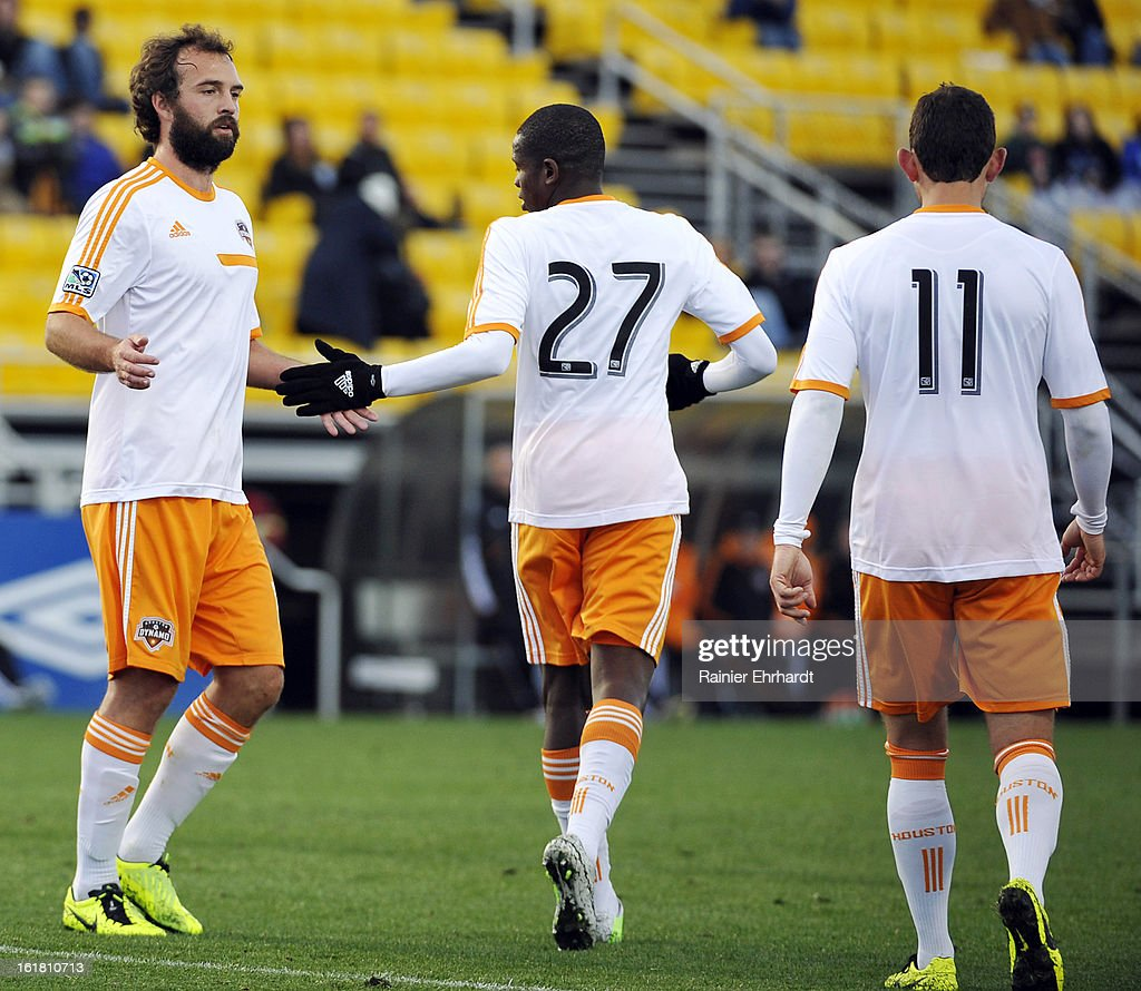 Adam Moffat #16 of the Houston Dynamo celebrates a goal with teammates Boniek Garcia #27 and Brad Davis #11 during the first half of their game against the Chicago Fire in the Carolina Challenge Cup at Blackbaud Stadium on February 16, 2013 in Charleston, South Carolina.