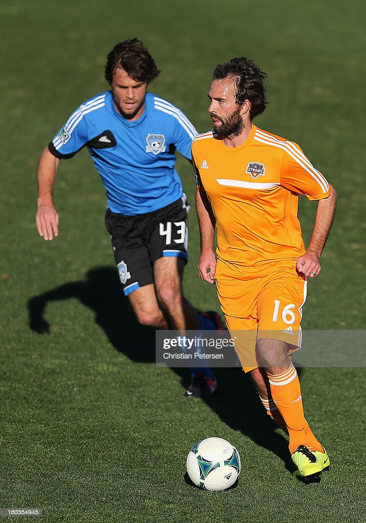 Adam Moffat #16 (R) of the Houston Dynamo controls the ball during The Desert Friendlies Presented By FC Tucson against the San Jose Earthquakes at Kino Sports Complex on January 29, 2013 in Tucson, Arizona. The Earthquakes defeated the Dynamo 2-0.
