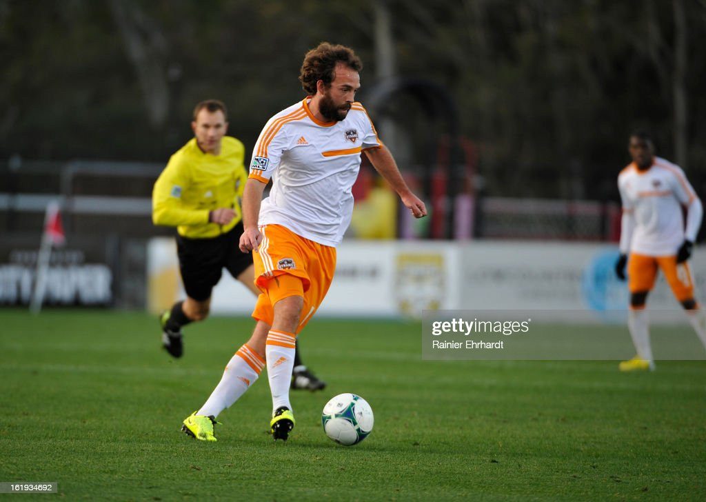 Adam Moffat #16 of the Houston Dynamo during the first half of their game against the Chicago Fire at Blackbaud Stadium on February 16, 2013 in Charleston, South Carolina.