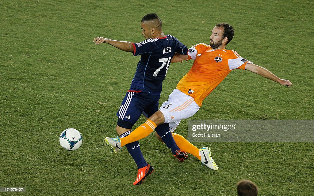 Adam Moffat #16 of the Houston Dynamo works the ball against Alex #71 of the Chicago Fire at BBVA Compass Stadium on July 27, 2013 in Houston, Texas.