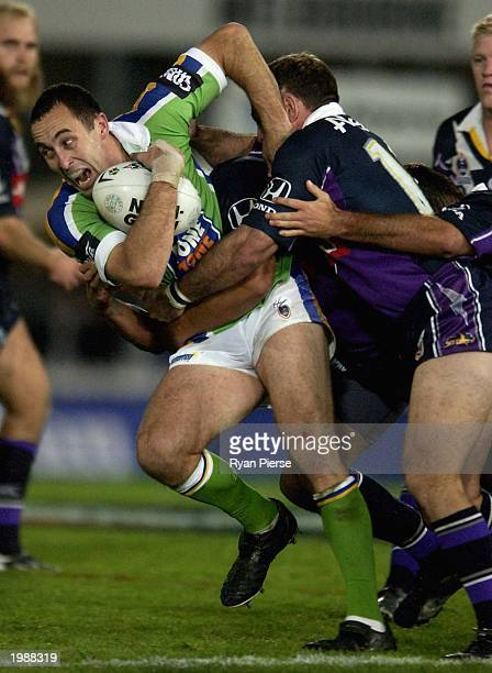 Adam Mogg for the Raiders is tackled by Danny Williams for the Storm during the Round nine NRL match between the Melbourne Storm and the Canberra...
