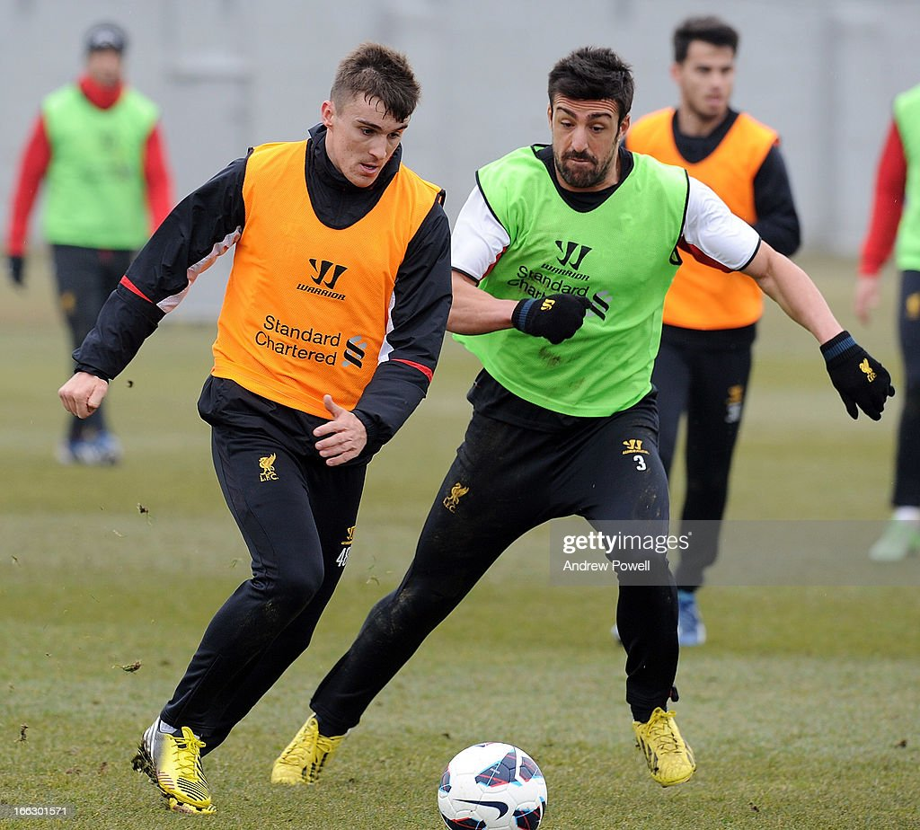 Adam Morgan and Jose Enrique of Liverpool in action during a training session at Melwood Training Ground on April 11, 2013 in Liverpool, England.