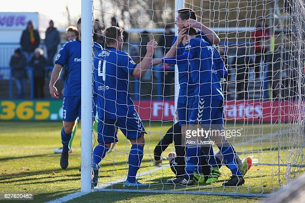 Adam Morgan of Curzon Ashton celebrates with team mates as he scores their second goal during the Emirates FA Cup second round match between Curzon...