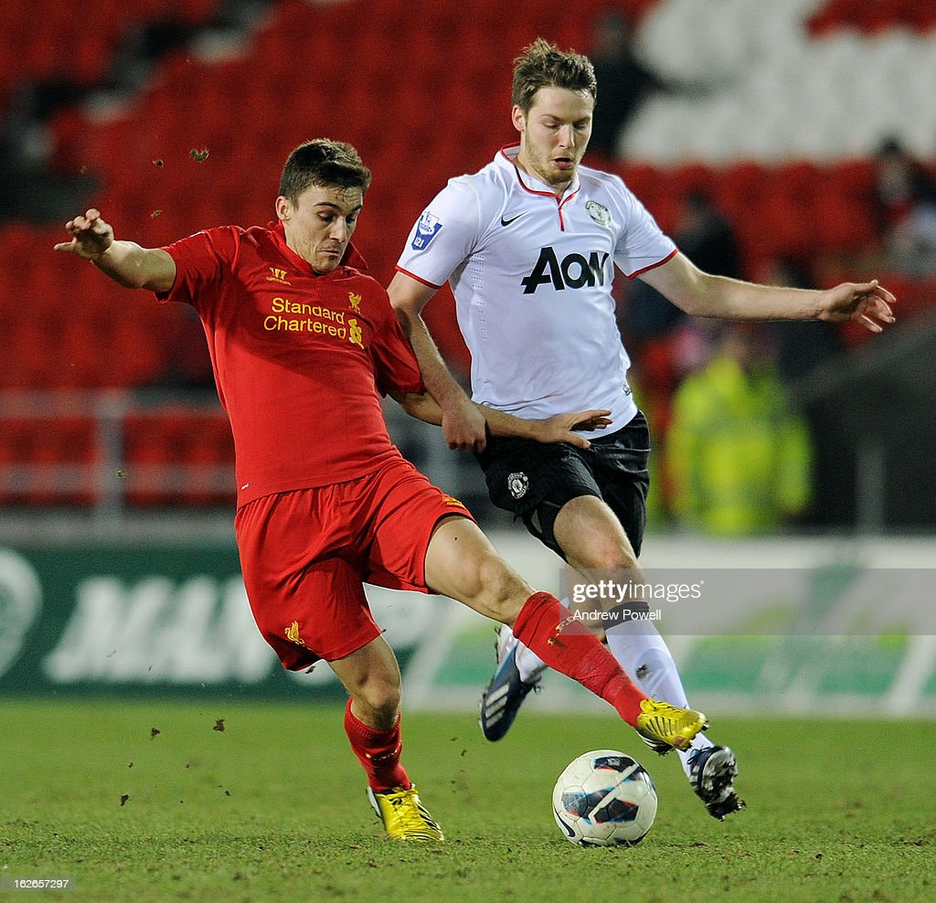 Adam Morgan of Liverpool competes with Nick Powell of Manchester United Reserves during the Barclays Premier Reserve League match between Liverpool Reserves and Manchester United at Langtree Park on February 25, 2013 in St Helens, England.