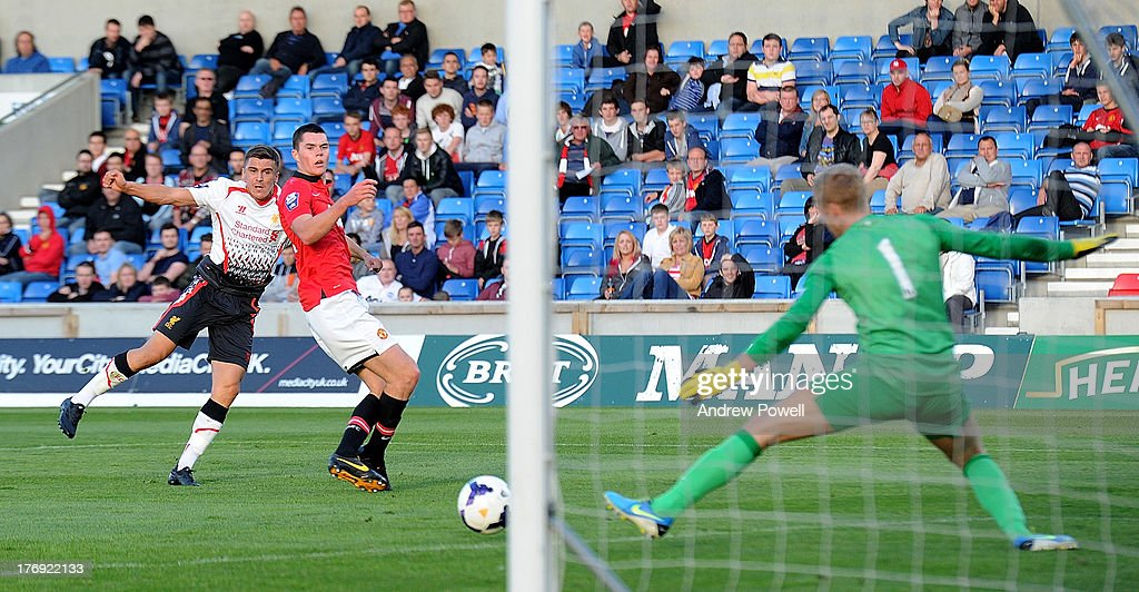 Adam Morgan of Liverpool scores the second during the Barclays U21s Premier League match between Manchester United U21 and Liverpool U21 at Salford City Stadium on August 19, 2013 in Salford, England.