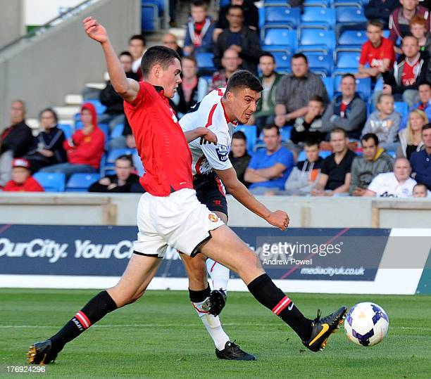 Adam Morgan of Liverpool scores the second goal during the Barclays U21s Premier League match between Manchester United U21 and Liverpool U21 at...