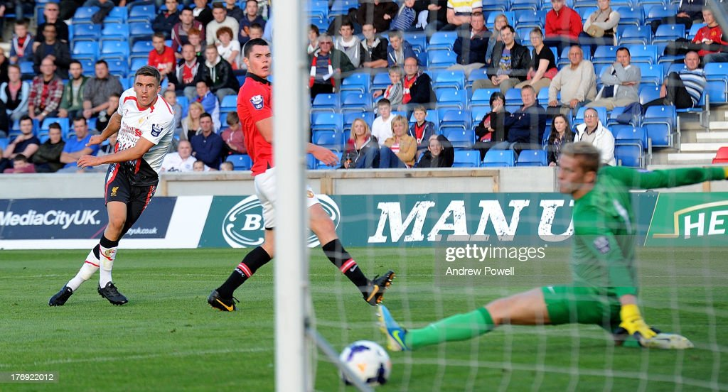 Adam Morgan (L) of Liverpool scores their second goal during the Barclays U21s Premier League match between Manchester United U21 and Liverpool U21 at Salford City Stadium on August 19, 2013 in Salford, England.