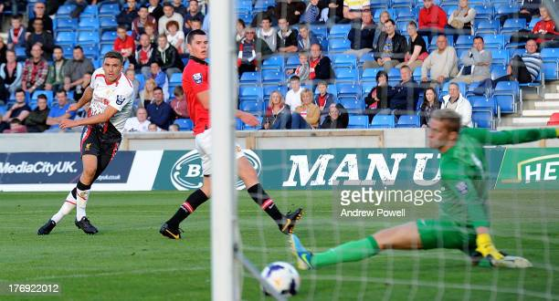 Adam Morgan of Liverpool scores their second goal during the Barclays U21s Premier League match between Manchester United U21 and Liverpool U21 at...