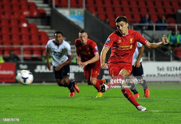 Adam Morgan of Liverpool U21 scores the opening goal from the penalty during the Barclays Premier U21 League match between Liverpool U21 and...
