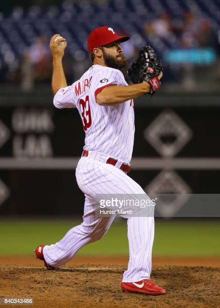 Adam Morgan of the Philadelphia Phillies throws a pitch in the ninth inning during a game against the Atlanta Braves at Citizens Bank Park on August...