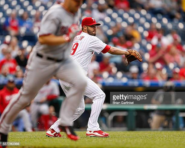 Adam Morgan of the Philadelphia Phillies throws Chris Heisey of the Washington Nationals out at first in the first inning of the game at Citizens...