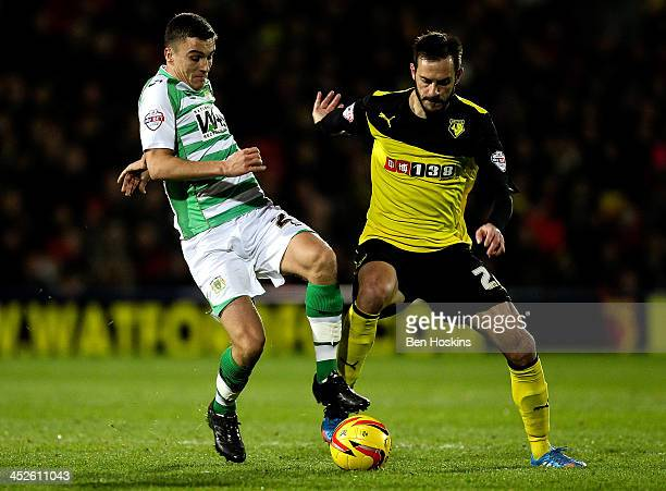 Adam Morgan of Yeovil holds off the challenge of George Thorne of Watford during the Sky Bet Championship match between Watford and Yeovil Town at...
